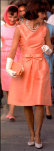 Jackie O in coral dress