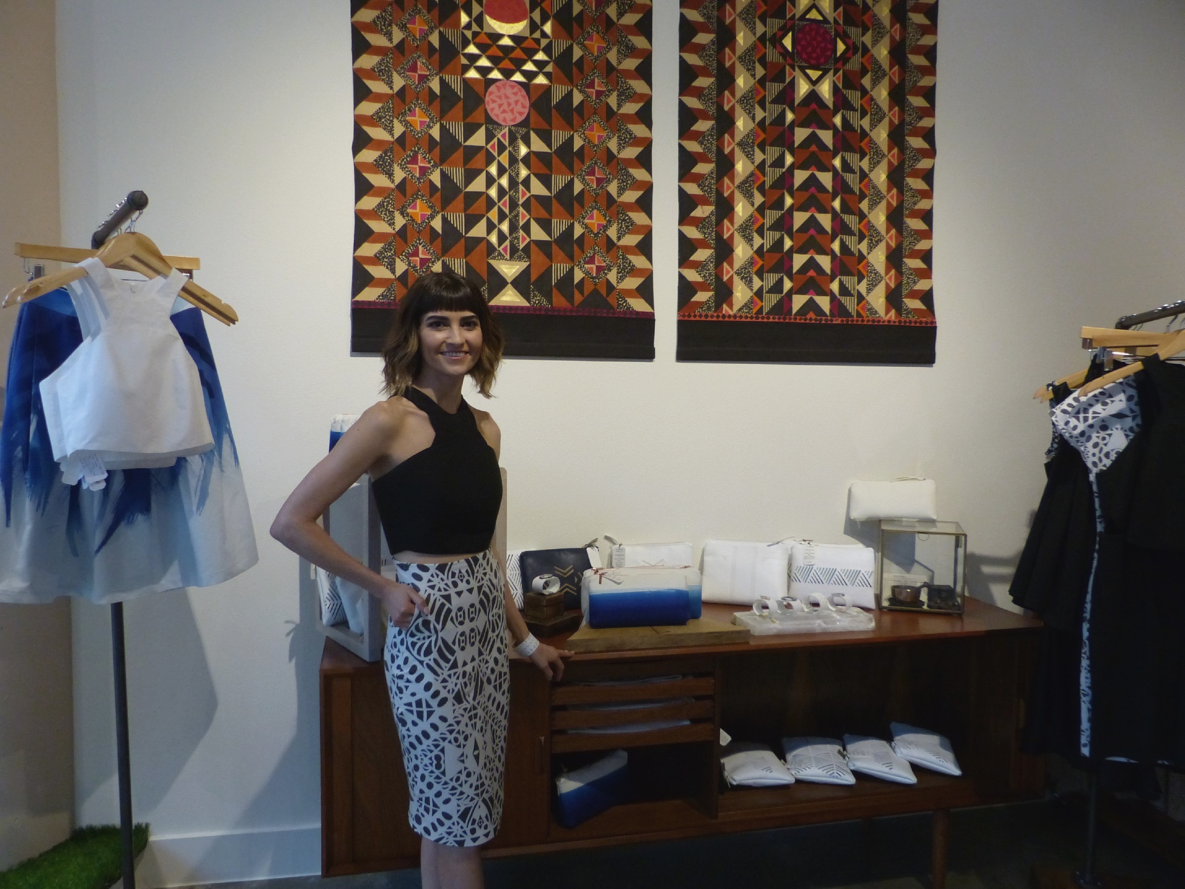 Stef standing next to her trunk show