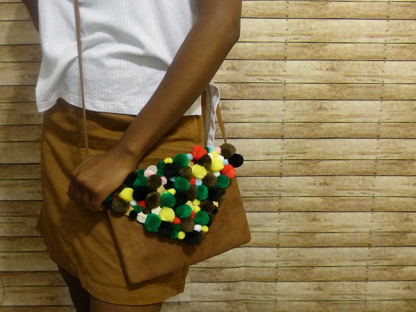 wearing pom pom bag